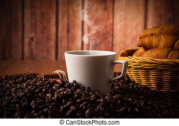 coffee still life on a wood background - cup with coffee and...