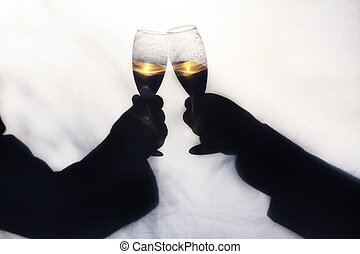 Silhoette of Champagne Toast - Two gay men toasting their...