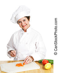 Chef Cuts Up Veggies - Petty female chef in her uniform,...