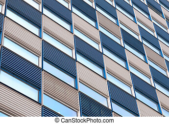 Office facade with ripples in blue and white and reflective...