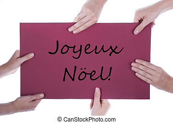 Hands Holding Sign Joyeux Noel - Many Hands Holding a Red...