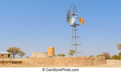 watermill pumping water farm - windmill pumping water into a...