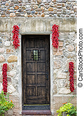 Hanging Chili Peppers Adorning a Stone Wall - Symmetrically...