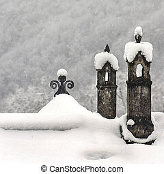 Chimneys under the white snow - Two chimneys in a snowy...