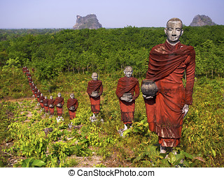 Row of Statues of Buddhist Monks - Hundreds of statues of...