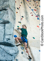 proud climber - Teen looking proud as she climbs an...