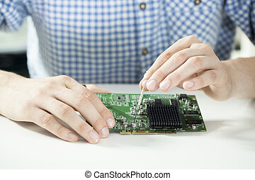 Male hands repairing computer hardware - Horizontal view of...