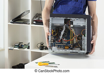 Man holding computer - Close-up of man holding computer
