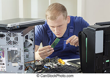 IT specialist installing ram memory - Young blonde IT...
