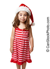 Girl wearing a santa hat at Christmas time - A pretty girl...
