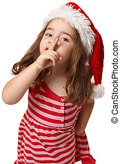 Little girl in santa hat gesturing peace and quiet