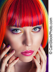 beautiful woman wearing colorful wig and showing colorful...