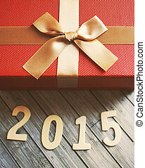 Happy new year 2015 with red gift box, retro filter effect