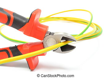 Metal pliers and green-yellow cable on white background -...