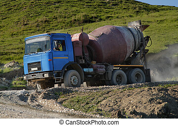 Ballast truck - Old ballast truck on a dirty road work.