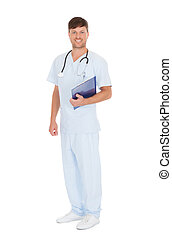 Portrait Of Confident Young Male Nurse Holding Clipboard -...