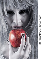 witch holding an apple - witch with long white hair holding...