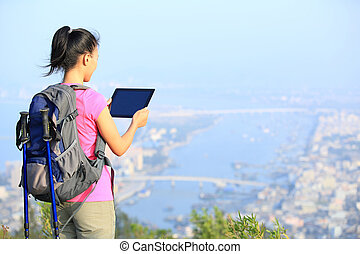 young woman hiker use smart phone taking photo at mountain...