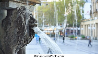 Lion statue and fountain on the square near Cologne...