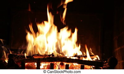 Bright flame of fire in an ancient fireplace
