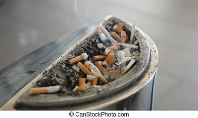 stub from a cigarette smokes in an ashtray