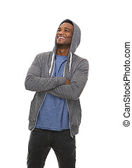 Handsome black man laughing with arms crossed