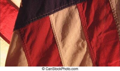 FlagTilt - CU of United States flag while camera tilts up...