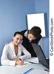 Two business person in a office