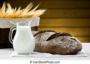 Bread and pitcher of milk on the table