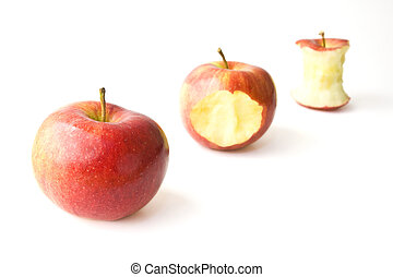 Juicy Apple Munching - Three juicy gala apples in different...
