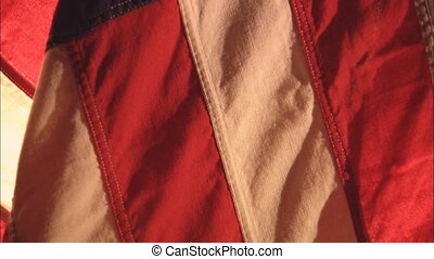 Flag Tilt To Out Of Focus 2 - CU of a pleated United States...