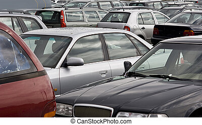cars on a parking lot - cars parking in a row on a parking...