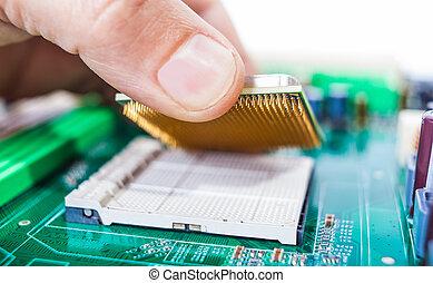assembles computer parts - male hand assembles computer...