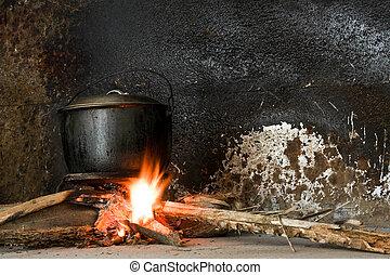 Cooking Pot On An Open Fire - A soot blackened iron pot...