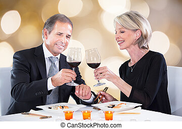 Happy Couple Toasting Wineglasses In Restaurant - Happy...