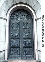 Ancient ornate door to the medieval church in Tallinn,...
