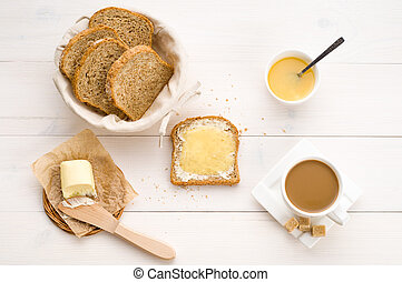 Breakfast including  bread, honey, butter and coffee