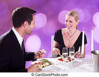 Couple Enjoying Candlelight Dinner At Restaurant - Happy...