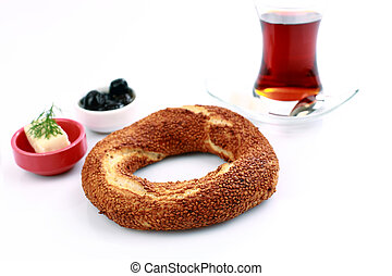 bagel - Turkish bagel, simit, and traditional tea on a white...