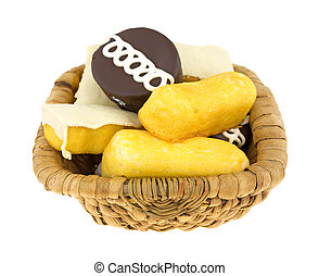 Junk food cakes and donuts in basket - An old wicker basket...