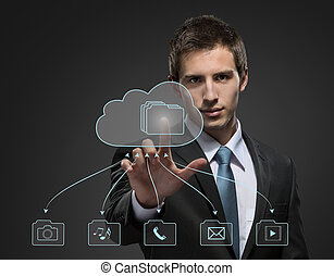 Young businessman working with virtual technology touching...