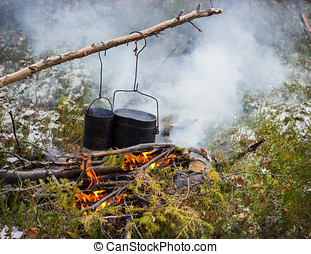 Cooking on a fire in field conditions