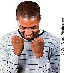 Young man with fists Clenched and overjoyed at success