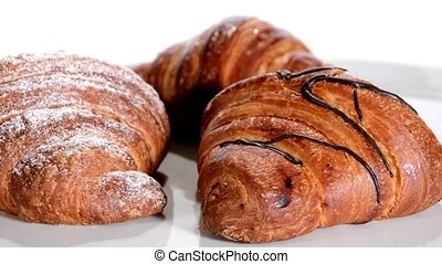Pastry Croissants isolated - Croissants rotating over white...