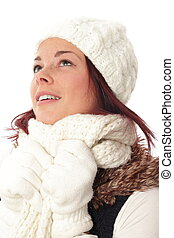 Young woman in winter looking hopefull