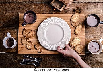 Homemade hot chocolate, homemade butter cookies, cream puffs