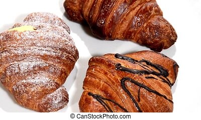 Pastry. Croissants isolated - Croissants rotating over white...