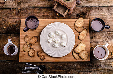 Homemade hot chocolate, homemade butter cookies, cream puffs