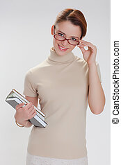beautiful girl with books and wearing glasses