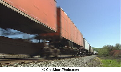Freight train Passing Panning - MS of freight train passing...